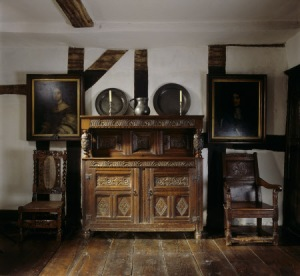 A 17th century carved oak court cupboard in Mr Whitgreave's Room at Moseley Old Hall, Staffordshire